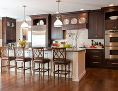 kitchen by Ginny Padula - darker cabs, lighter island, medium floors. butcher block island top.