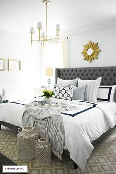 Adding summer touches to your bedroom is as simple as throw pillows, a casual throw, and some pretty coastal accents. Bring in the season with these these no-fail tips for a relaxing and airy summer bedroom! #bedroom #masterbedroom #summerdecorating #coastaldecor