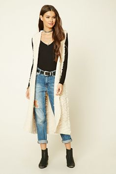 A loop knit longline cardigan featuring an open front, an attached hood, sleeveless cut, and ribbed knit trim.