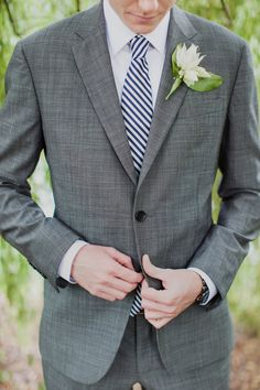 groom style. striped tie. http://www.weddingchicks.com/2013/11/25/big-bash-wedding/