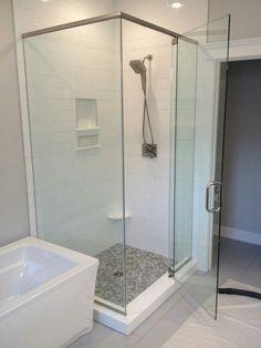 Frameless shower enclosure. #brittandtilsonglass #asheville #showerenclosure #framelessshower