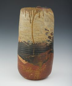 """Toshiko Takaezu (American, b. 1929) Hand built glazed stoneware closed vessel, .17-1/4""""H x 8""""D, with naturalistic earthtone glazes, with the artist's mark incised in the underside."""