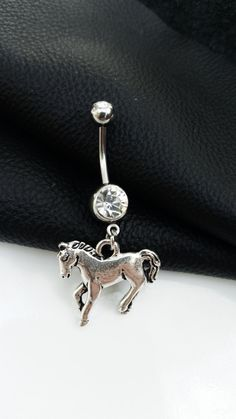 This pretty belly button piercing is surgical steel with a nice silver metal…
