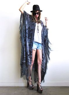 """Soooooooo GOOD!  Gorgeous velvet burnout caftan with a Baroque floral pattern and silk fishnet fringe all along sides and bottom.   Great with anything and everything year round! So many ways to wear and style, dressed up or down, simply effortless and timeless!  Color: Gray on BlackOne size fits allTotal length including fringe is 51""""The velvet burnout process, or """"D?vor?"""" as it is also referred, is achieved by applying an acid to a natural, protein f..."""