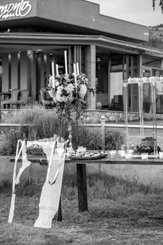 Reflection of a man next to a wedding decorated table