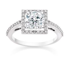 2 29 Round Cut 0 82 Carat Halo Engagement Ring With Side Stones In Platinum