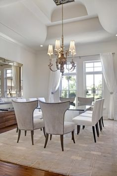White can also give height to structural elements, as in this dining room, where the sculptural deep tray ceiling is the main focal point. The elegant light, neutral shades in the rest of the room range from frost to cream, with accents of warm natural wood. (via Sunscape Homes, Inc)