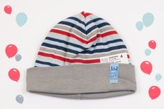 Striped varicolored hat with a gray edging. 100% cotton, well worn and washing without loss of color. Will always keep your child warm during the winter. Perfect for a walk outside with your child. Adorable as same as its price. Don't miss this offer!