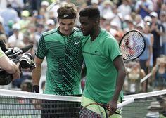 Roger Federer, Frances Tiafoe Roger Federer, of Switzerland, left, meets Frances Tiafoe at the net after their match during the Miami Open tennis tournament, in Key Biscayne, Fla. Federer won 7-6 (2), 6-3 Tennis, Key Biscayne, U