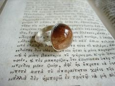 This rutilated quartz ring almost glows anytime the light comes near it! This handmade piece has such a lovely personality, you'll fall in love with this 'anything but neutral' neutral stone. Silver Rings Handmade, Silver Gifts, Sterling Silver Rings, Memphis, Rutilated Quartz Ring, Silver Engagement Rings, Ring Engagement, Custom Wedding Rings, Ancient Jewelry