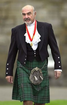 Another famous Scottish knight of the realm. Sir Sean Connery wears full highland dress as he walks towards waiting journalists after he was formally knighted by Queen Elizabeth II at Holyrood Palace in Edinburgh.