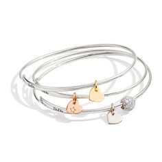 Dodo silver bangles with Heart charms in rose, white or yellow gold bring you More Love every day. Discover all products