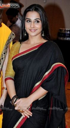 Vidya Balan black saree..nicely matched with a  mustard blouse..the border of the blouse matches with the saree..