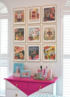 "Colorful ""Travel the World"" gallery wall made from calendar pages.  Tips and ideas for creatively decorating blank walls. BHG Style Spotters"