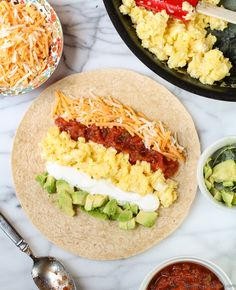 Easy Breakfast Burrito- packed with protein and flavor, a tasty way to start a busy school day. #breakfast #backtoschool