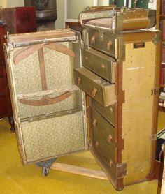 1924 Hartmann Cushion Top Wardrobe Trunk Vintage Suitcase, all original. $415.00, via Etsy.