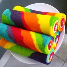 Rainbow cake rolls with icing.