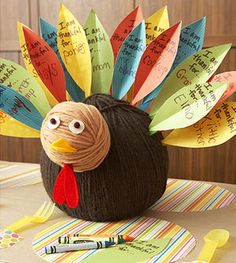 """This yarn turkey with """"thankful"""" feathers would make a darling centerpiece at any #Thanksgiving table."""