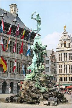Brabo Statue and fountain in market place across from City hall. Antwerp, BELGIUM