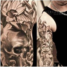 Skull and flowers arm tattoo