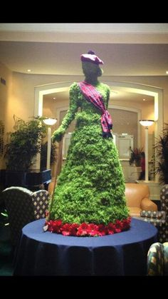 Scottish golfer made of of moss and gerbera   daises for ladies golf tournament event-