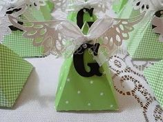 angel centerpiece   Use triangle boxes with angel wings, add the baby's initial and you ...