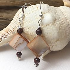 """Handmade earrings are always a favourite for Mother's Day! These lovelies are in sterling silver with poppy jasper and some gorgeous vintage shell beads. Fun and funky in this season's trending colour, """"chilli oil"""". PS: free gift wrapping is included! Gemstone Earrings, Dangle Earrings, Shell Jewelry, Unique Jewelry, Color Trends, Earrings Handmade, Jasper, Poppy, Ps"""
