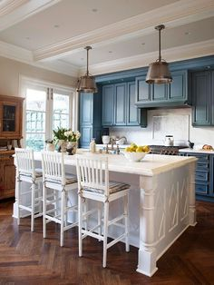 Elegant and casual elements combine in this functional space  Click     I love blue and white kitchen  but the white cabinets drive me crazy  sometimes  This might be a good fix  paint the cabinets navy and the walls  white or
