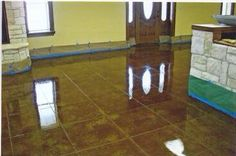 Beautiful scored and stained concrete by Concrete Expressions