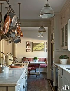 Both functional and sophisticated, pot racks add irresistible charm to these seven stylish kitchens
