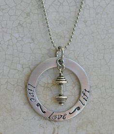 Live Love Lift  - Doubt I'd ever wear it as a necklace, but maybe as a small charm on a bracelet?