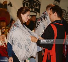 Catherine Duchess of Cambridge receives gifts as she attends an official welcome and performance from Bella Bella First Nations Community at Wawiska...