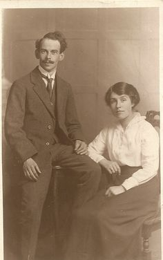 Possibly betrothal photograph, c.1914-17. During the 1910s a plain blouse and calf-length skirt were typical women's wear, a tailored jacket being added for outdoors. Men's lounge jacket lapels were often longer by this decade, the winged shirt collar seen here a formal choice. (Katharine Williams
