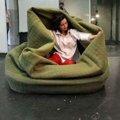 The Moody Nest is an updated nest-like sofa that transforms into an adult-friendly blanket fort