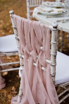 Vintage look. Distressed chiavari chairs with muted pink weaved fabric