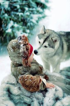 Child with white wolf