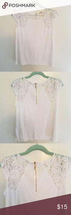Guess cap sleeve shirt White shirt with lace cap sleeves by Guess. The back has a cute little gold zipper. The picture of the front looks like there is a spot but it's just the zipper showing trough. Guess Tops Tees - Short Sleeve