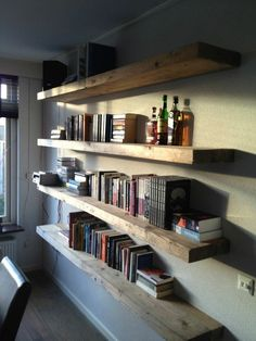 floating bookshelves / living room / above sofa