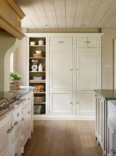 These units are in an archetypal country style and the dresser in the dining area is also imbued with rural charm | Designed by Garry Meakins, head of design, Sims Hilditch | Photograph by Darren Chung | Homes & Gardens | http://www.hglivingbeautifully.com/2016/05/19/natural-fit-a-beautiful-19th-century-farmhouse-kitchen/