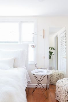 neutral bedroom w/ wall sconces