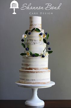 Semi- naked Boho Wedding Cake by Shannon Bond Cake Design www.sbcakedesign.com  Nearly nakes, half-dressed, semi-naked, whatever you want to call them, these lightly buttercream beauties are delicately rustic yet elegant. Paired with a boho style chic sugar flower and berry wreath brings a little whimsy to this design.