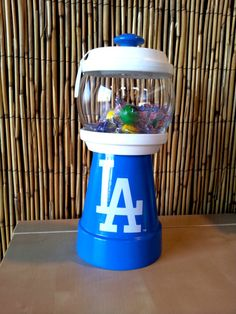 Customized/Personalized Los Angeles Baseball/Sports Team Inspired Gumball Machine Candy Jar.   Can be used for candy, nuts, change, beta fish, q-tips, cotton balls, hair pins or anything you can think of.  Visit Julie's Kraft Shack @ https://www.facebook.com/JuliesKraftShack