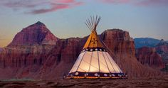 Glamping is a great way to experience the national parks in Utah. Capitol Reef Resort has teepees and conestoga wagons available where guests can have an outdoor experience with luxury amenities.