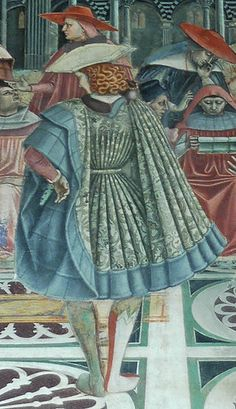Pellegrinaio Santa Maria della Scala, Siena. Back view of a knee-length Italian cioppa or houppelande of figured silk. One sleeve is turned back to the shoulder to reveal the lining and the doublet sleeve beneath. Sienna, 1442.