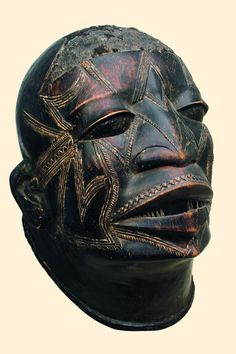 """Tanzania, Makonde light brown wood, dark brown patina, nearly naturalistic facial features, the whole face coated with scarification marks, coiffure with remains of real hair, min. dam., slight traces of abrasion, minor missing parts (teeth), on metal base; """"lipiko"""" masks appeared at initiation celebrations. They were worn by the young male initiates """"vaali"""" at the """"mapiko"""" masquerade. They were kept in special sacred mask houses outside the village. Women were not allowed to see them. H…"""