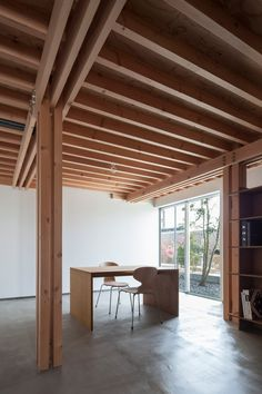 Exposed ceiling beams and joists Composite timber column  Burnished concrete floor 4 Columns House, Tokyo FT Architects