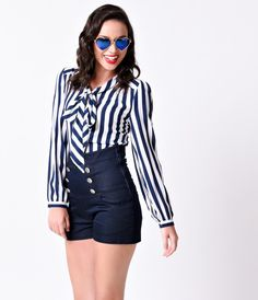 Tie it up and sail away, dames. A soft, airy navy and white striped nautical style top, complete in a 1940s blouse design with a darling self tie. Crafted in an unlined weave in a button up style, with subtle gathers, a back yoke and long sleeves with but