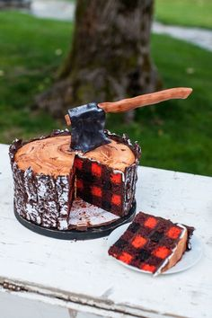 I'd like to interrupt your Monday morning drudgery to present you with this impossibly important lumberjack cake. As you can see, the outside looks like a tree stump, while the inside of the cake looks like a red flannel shirt straight out of a Woolrich catalog. The cake is topped with an ax made out of fondant. So rugged. Honestly it