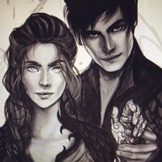 Rhys and Feyre. A Court of Thorns and Roses and A Court of Mist and Fury. SJM