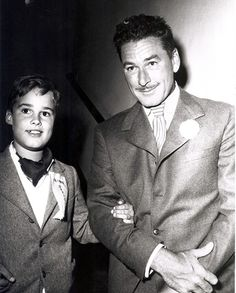 Errol Flynn towards the end of his life, and his son Sean, at the Follies charity show